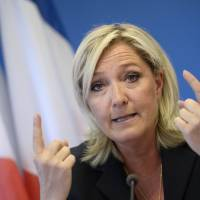 After riots, Le Pen seeks end to dual nationality