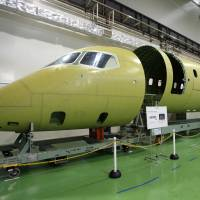 Components for Mitsubishi Aircraft Corp.'s Mitsubishi Regional Jet are put on display for a media preview at the Nagoya Aerospace Systems Works Tobishima Plant in Aichi Prefecture last September. | BLOOMBERG