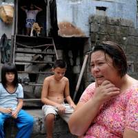Beirut Calaguas speaks about her life as an Amerasian child while some of her children sit nearby during an interview in the Philippine city of Angeles in May. | AFP-JIJI