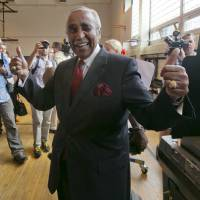 Rep. Charles Rangel, a Democrat, gives the thumbs-up sign after voting in congressional primaries in New York on June 24. The 84-year-old fended off a strong challenge in the race as he aims for a 23rd term. | AP