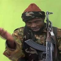 This May 12 screen grab from a video made by Nigerian terrorist group Boko Haren shows its leader, Abubakar Shekau. The United States is reportedly going to fund a TV channel in Nigeria to counter insurgencies organized by such groups. | AFP-JIJI