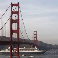 The Queen Mary 2 sails beneath San Francisco's Golden Gate Bridge in February 2007. Officials said Monday that with $76 million in funds in place, they are considering a long delayed proposal to equip the bridge with suicide prevention devices. | BLOOMBERG