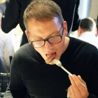 A chef from a London restaurant tries 'wagyu' beef during a tasting event on Monday. | KYODO