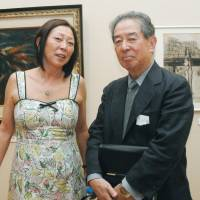 Family secrets: Writer Chihiro Isa and his sister Momo Yashima attend an exhibition in Kagoshima city to mark the 100th anniversary of the birth of their biological father, anti-establishment artist Taro Yashima, who escaped to America in 1939 after being arrested several times by the fascist Japanese government of the time. Isa and his siblings were unaware of their father's identity until later in life. | KYODO