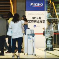 Mizuho boss vows reforms after loan scandal