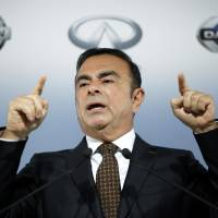 Carlos Ghosn, chairman and chief executive officer of Nissan Motor Co., holds a news conference at the company's headquarters in Yokohama on May 12. | BLOOMBERG