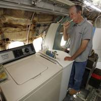 Bruce Campbell is seen at home in his Boeing 727 in late May. The former engineer planned originally to build a home inside freight vans on his land, but decided on a plane instead. He says he believes most people are nerds at heart, and says that is a good way to live. 'The point is to have fun,' he said. | REUTERS