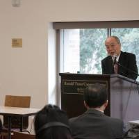 Minority view: Hidenori Sakanaka speaks in April at the 'Immigration Nation Japan?' symposium at the University of Southern California in Los Angeles. | MATT MONTROSE