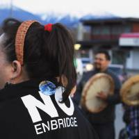A Haisla woman wearing a traditional tree bark headband attends a protest against the Northern Gateway pipeline in Kitimat, British Columbia, in April. | REUTERS