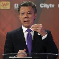 Santos re-elected Colombia president in peace vote