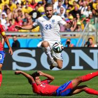 Nothing to lose: England's Luke Shaw hurdles a tackle during Tuesday's 0-0 draw with Costa Rica in Belo Horizonte, Brazil. | AFP-JIJI