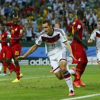 Goal machine: Germany striker Miroslav Klose celebrates after scoring in his team's 2-2 draw with Ghana in Fortaleza, Brazil on Saturday. | REUTERS