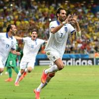 Greek legend: Greece's Georgios Samaras celebrates after scoring an injury-time penalty to send his country through to the second round of the World Cup with a 2-1 win over Cote d'Ivoire on Tuesday. | AFP-JIJI