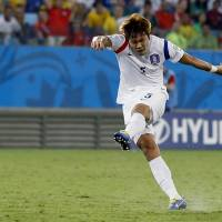 Let it fly: South Korea's Kim Young-gwon takes a shot during his team's 1-1 draw with Russia in World Cup Group H in Cuiaba, Brazil on Tuesday. | AP