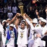 We are the champions: The Spurs celebrate after winning the NBA title on Sunday in San Antonio. | REUTERS