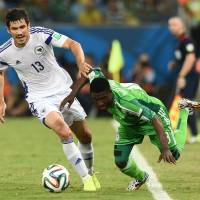All or nothing: Bosnia-Herzegovina's Mensur Mujdza (left) challenges Nigeria's Michael Babatunde during the Nigerians' 1-0 win on Saturday. | AFP-JIJI