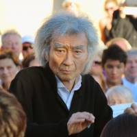 Seiji Ozawa conducts young string players Thursday in Rolle, Switzerland, in his first international appearance in three years or so. | KYODO