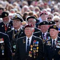 World War II veterans listen to a reading at an event held in Arromanches-les-Bains, France, on Friday during a ceremony marking the 70th anniversary of the Allied landings in Normandy. | AFP-JIJI