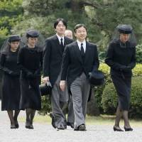 Crown Prince Naruhito and Crown Princess Masako walk together with Prince Akishino and his wife, Princess Kiko, and daughter, Princess Mako, during Prince Katsura's funeral service on Tuesday morning. The event was held at Toshimagaoka cemetery in Tokyo's Bunkyo Ward. | KYODO