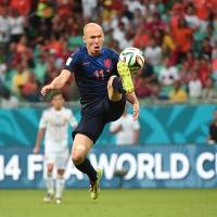 Sweet revenge: Arjen Robben controls the ball during the Netherlands' 5-1 victory over Spain on Friday in Salvador, Brazil. | AP