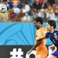 Back in it: Wilfried Bony heads Cote d'Ivoire's equalizer in the 64th minute against Japan on Saturday. | AFP-JIJI