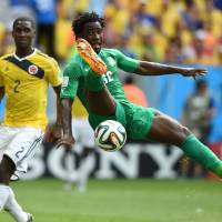 Nowhere but down: Cote d'Ivoire's Wilfried Bony goes airborne as Colombian defender Cristian Zapata looks on during their match on Thursday in Brasilia. | AFP-JIJI