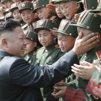 Weapons experts generally agree that North Korea has several nuclear bombs and could be close to designing one small enough to fit on a missile. In this image, North Korean leader Kim Jong Un is seen visiting Mangyongdae Revolutionary School on the 68th anniversary of the founding of the Korean Children's Union in Pyongyang. | REUTERS
