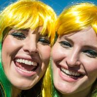 Brazilian fans cheer on their team outside Mineirao Stadium in Belo Horizonte, ahead of the Brazil vs. Chile match Saturday. A poll found those with seats in the stadiums are overwhelmingly white and from the wealthier sections of society.   AFP-JIJI