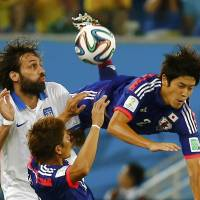 Japan's World Cup chances take hit after draw against 10-man Greece