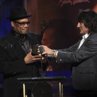 The Rolling Stones' Ronnie Wood inducts Bobby Womack into the Rock and Roll Hall of Fame during a ceremony in Cleveland in April 2009. His publicist said Friday the famed singer-songwriter has died at age 70. | REUTERS