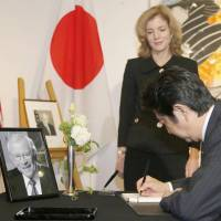 Abe signs condolence book for former envoy Baker