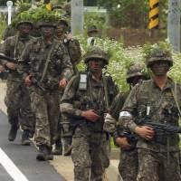 South Korean soldiers patrol during a a manhunt for a fellow soldier who shot dead five of his comrades Sunday in Goseong at a base near the North Korean border. | REUTERS