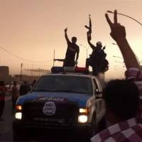 An image grab taken from a video uploaded on YouTube on June 12 allegedly shows Islamic State of Iraq and the Levant (ISIL) militants taking part in a military parade in the northern city of Mosul. The group's stunning successes and brutal tactics are creating an unusual mix of alliances in the Mideast between actors intent on halting their advance toward Baghdad. | AFP-JIJI