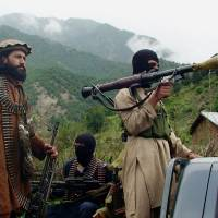 Pakistani Taliban patrol their stronghold of Shawal in the country's South Waziristan tribal region in August 2012. The Pakistani Army launched a 'comprehensive operation' against foreign and local militants in a tribal region near the Afghan border Sunday. | AP