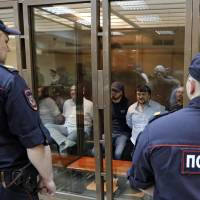Five sentenced for slaying of Russian journalist, but mastermind remains unknown