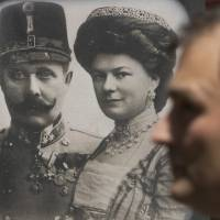 Tourists pass portraits of Archduke Franz Ferdinand and his wife, Sofia von Hochenberg, at a Sarejevo museum on Saturday. Bosnia marked a century since the assassination of Ferdinand, the heir to the Austro-Hungarian throne, and his wife by Serb nationalist Gavrilo Princip on June 28, 1914, the event that precipitated the start of World War I. | AP