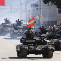 A military parade in Moldova's pro-Russia separatist Transdniestr province, seen in September 2010 during a commemorations marking the region's Independence Day. | REUTERS