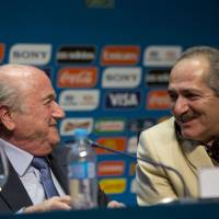 FIFA President Sepp Blatter (left) talks with Brazilian Sports Minister Aldo Rebelo on Thursday in Sao Paulo during a news conference where they talked about the organization and infrastructure of the World Cup, which will start on June 12. | AP