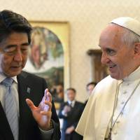 Prime Minister Shinzo Abe speaks with Pope Francis during a private audience at the Vatican on Friday. | AP