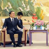 China opens up to holding first formal talks between Xi, Abe