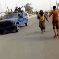 Militants from the al-Qaida-inspired Islamic State of Iraq and Syria arrive at Iraq's largest oil refinery in Beiji, some 250 km (155 miles) north of Baghdad on Tuesday, in this video grab taken from a militant social media account.   AP