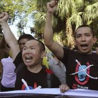 Vietnamese protesters chant anti-China slogans in Hanoi on Thursday, when China said it is moving a second oil rig closer to Vietnam's coast. Vietnamese authorities broke up a small protest against the move on Thursday. | AP