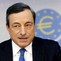 European Central Bank chief Mario Draghi speaks at a news conference in Frankfurt on Thursday. The European Central Bank has cut two key interest rates, one of them into negative territory, in a highly unusual step that underlines the urgency of its efforts to keep the eurozone economy from sliding into crippling deflation. | AP