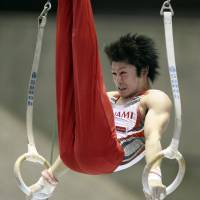 Lord of the rings: Kohei Uchimura performs at the NHK Cup at Yoyogi National Gymnasium on Sunday. | KYODO