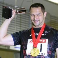 Athletic icon: Koji Murofushi receives a gold medal for winning his 20th straight national title in the hammer throw on Saturday in Fukushima. | KYODO