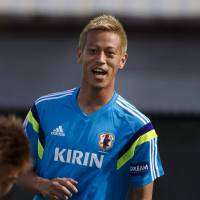 Think big: Keisuke Honda takes part in a training session with his Japan teammates in Clearwater, Florida on Saturday. | REUTERS