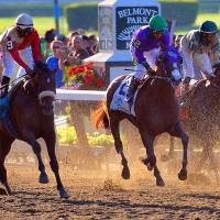 Not to be: Victor Espinoza crosses the finish line atop California Chrome at the Belmont Stakes on Saturday. California Chrome finished in a dead-heat for fourth, with Tonalist winning the race. | AP