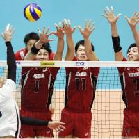 Towers of power: Members of the Japan team attempt to block an attack from France's Marechal Nicolas (16) during their World League match on Saturday in Kyoto. | KYODO