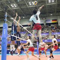 From the left side: Japan's Dai Tezuka spikes the ball against France on Sunday. FIVB