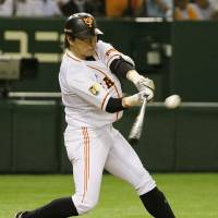 Providing a spark: The Giants' Hisayoshi Chono strokes a two-run triple in the fourth inning against the Buffaloes on Tuesday at Tokyo Dome. Yomiuri defeated Orix 8-0, extending its winning streak to seven games.  | KYODO